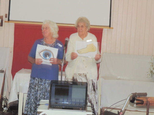 Val Smith (in blue) and Dorrie Thamm performing a skit