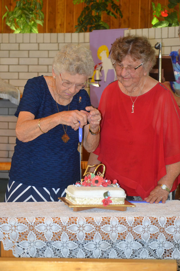 Cutting Anniversary cake Mrs. Pearl Weier first Vice President of the Guild 1967 with Mrs. Elsie Oddi President 2017